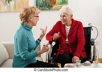 Elderly women talking - Elderly daughter visiting his...