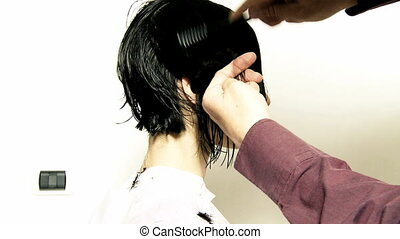 Side haircutting for bob with razor - Woman getting haircut...