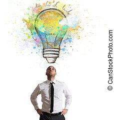 Creative idea - Businessman illuminated with a big creative...