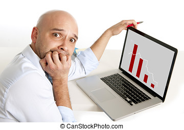 bald worried south american businessman biting his nails on...
