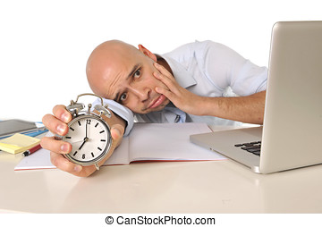 Overworked exhausted bald business man with computer and...