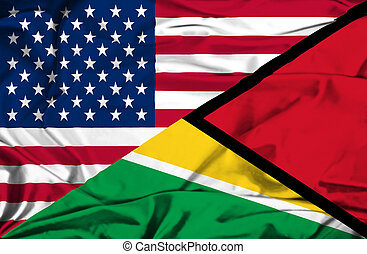 Waving flag of Guyana and USA