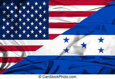 Waving flag of Honduras and USA