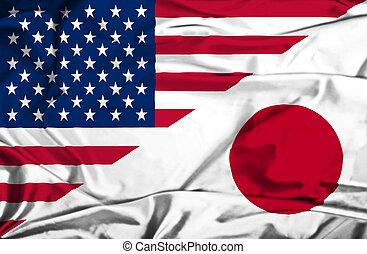 Waving flag of Japan and USA