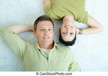 Couple lying on floor - Love couple lying on floor with...