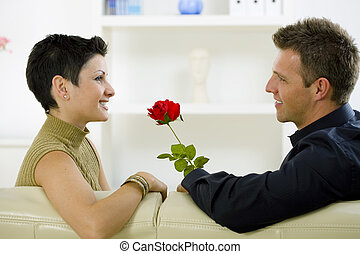 Love couple - rose - Romantic man giving red rose to woman...