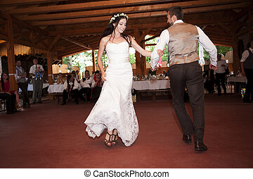 Bride and groom dancing at the wedding reception