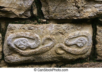 Kuelap Ruin Snake Pictograph - Closeup details of a carved...