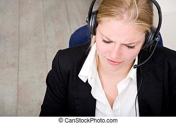 Dedicated receptionist - A dedicated receptionist at work,...