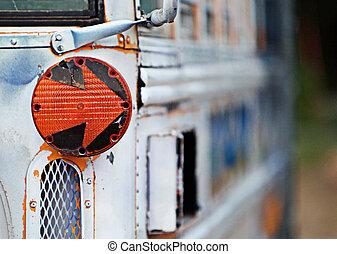 School Bus Arrow - An orange arrow turn-signal on an old...