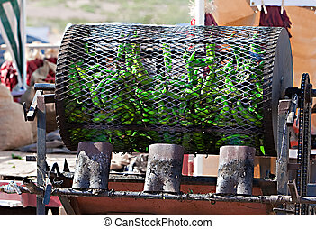 Green Chili Roasting - Green chilis are fire roasted in a...
