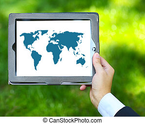 Man holding tablet computer with world map