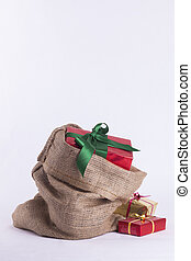 Wrapped Christmas present in Hessian sack with extra gifts...