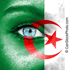Woman face painted with flag of Algeria