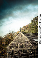 Yorkshire stone building against stormy sky