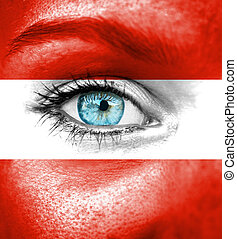 Woman face painted with flag of Austria