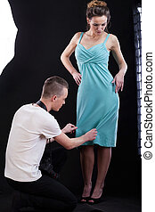 Taking photo of a dress - Photographer corrcting the blue...