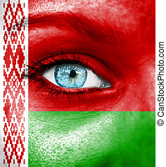 Woman face painted with flag of Belarus