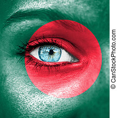 Woman face painted with flag of Bangladesh