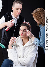 Hairdresser and make-up artist working - Hairdresser and...
