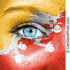 Woman face painted with flag of Bhutan