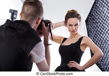 Young photographer working with professional model - Young...