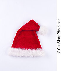 Red and white folded over Santa hat on white background -...
