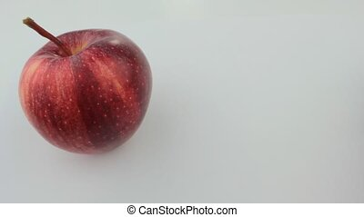 Rolling apple, red and green