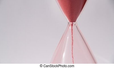 Red sand hourglass on white background