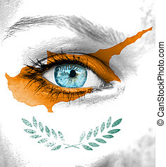 Woman face painted with flag of Cyprus