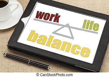 work life balance concept on a digital tablet with a cup of...