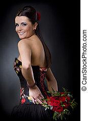Flirtatious glance - Beautiful young woman posing in a black...