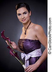 Woman with flower - Studio portrait of a beautiful young...