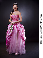 Bride in pink - Portrait of a happy young bride posing in a...
