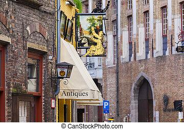 Signs outside antique shop Bruges