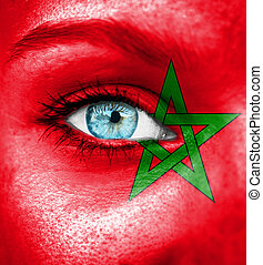 Woman face painted with flag of Morocco