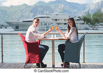 couple having lanch at beautiful restaurant - happy young...