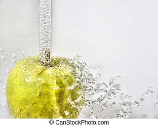 Sparkling apple - A green apple under a water fall, water...