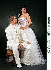 Wedding couple - Portrait of wedding couple. Bride wearing...
