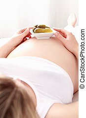 Pregnant woman with pickles
