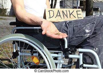 Homeless wheelchair user asking for money