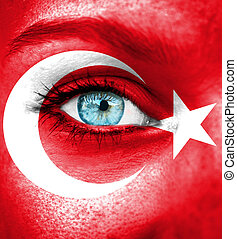 Woman face painted with flag of Turkey