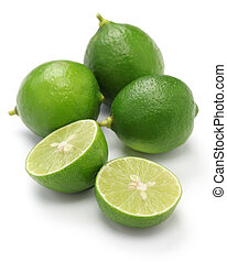 fresh key limes on white background