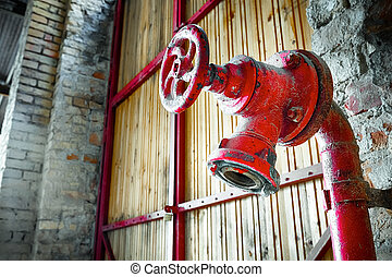 fire hydrant - hydrant in an old factory building interior...