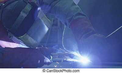 Welding a steel parts with gas arc welding - Welding a steel...