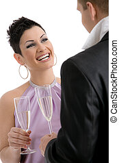 Woman clinking with champagne - Happy young woman clinking...