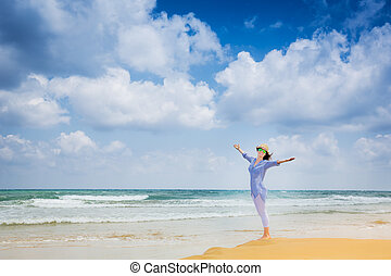 Happy woman at the beach - Happy young woman at the beach....