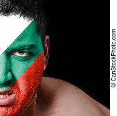 Portrait of angry man with painted flag of Bulgaria