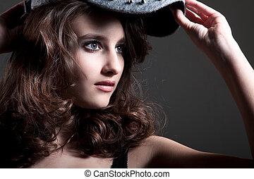 Young pretty woman with cap