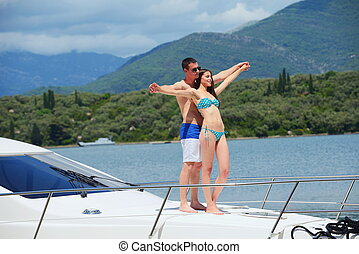 young couple on yacht - Romantic young couple spending time...